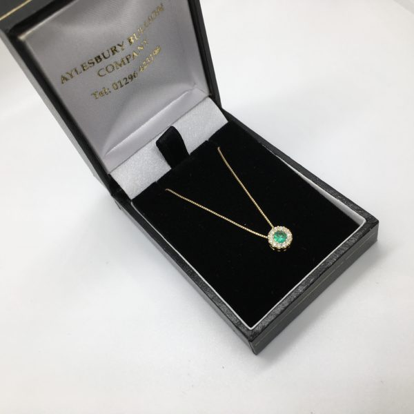 Preowned 18 carat white gold emerald and diamond pendant and chain