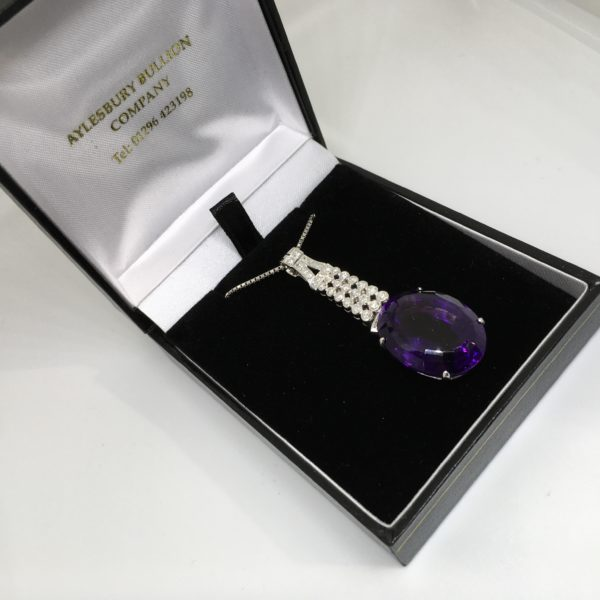 Preowned 14 carat white gold amethyst and diamond pendant and chain