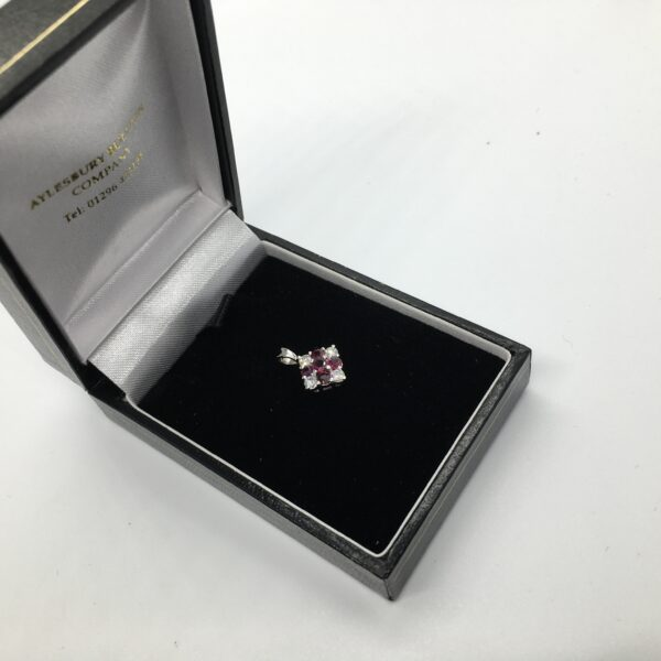 Preowned 18 carat white gold ruby and diamond pendant