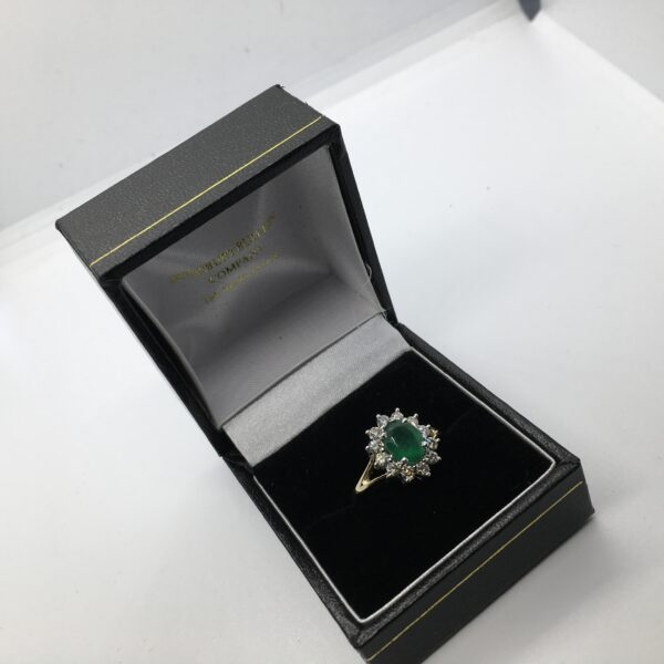 9 carat yellow gold emerald and diamond cluster ring