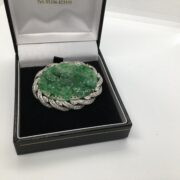 Preowned platinum, diamond and Carved jade brooch