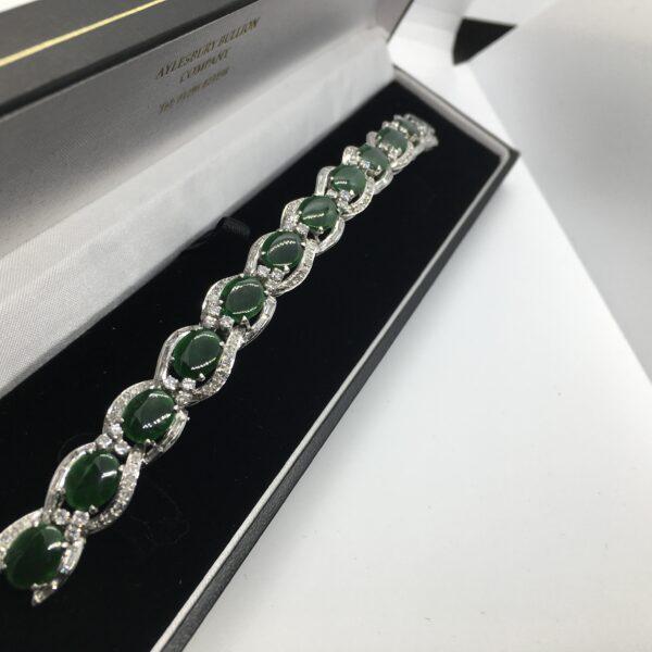 Preowned platinum, jade and diamond bracelet
