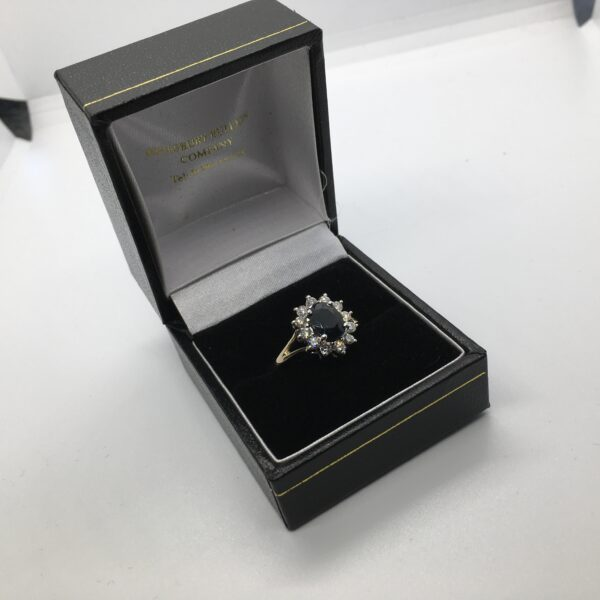 9 carat yellow gold sapphire and diamond cluster ring