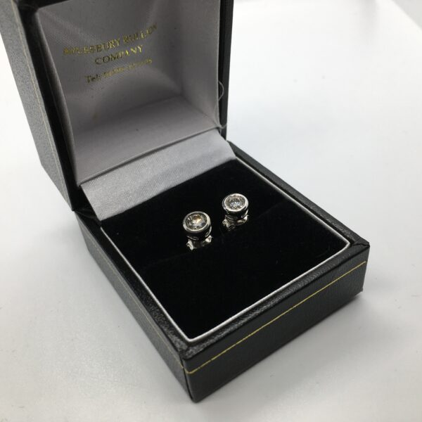 Preowned 9 carat white gold single stone diamond stud earrings