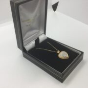 Preowned 9 carat yellow gold diamond heart pendant and chain