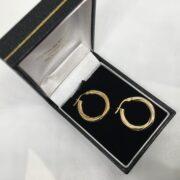 Preowned 9 carat yellow gold twist hoop earrings