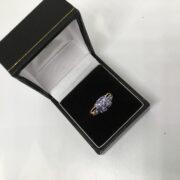 Preowned 9 carat yellow gold tanzanite and diamond ring