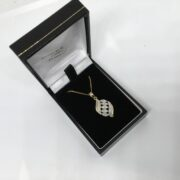 Preowned 9 carat yellow gold diamond set pendant and chain