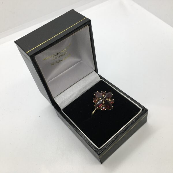 Preowned 9 carat yellow gold garnet cluster ring
