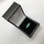 Preowned 9 carat yellow gold emerald ring