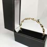 Preowned 9 carat yellow gold twist bangle