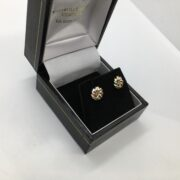 9 carat 3 colour gold knot earrings