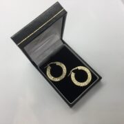 9 carat yellow gold patterned hoop earrings