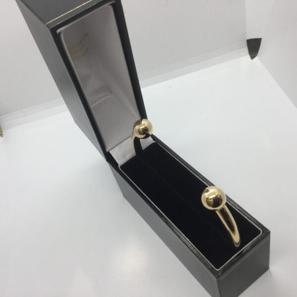 9 carat yellow gold torque bangle