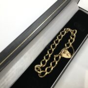 Preowned 9 carat yellow gold charm bracelet