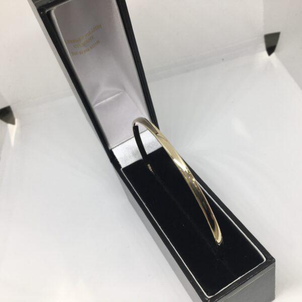 9 carat yellow gold solid bangle