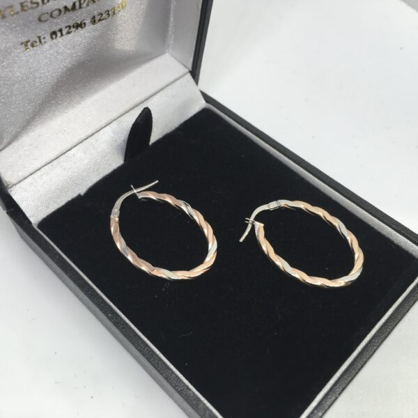 9 carat rose and white gold oval hoop earrings