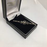 Preowned 9 carat 2 colour diamond set brooch