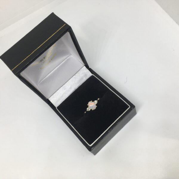 9 carat yellow gold opal and diamond ring