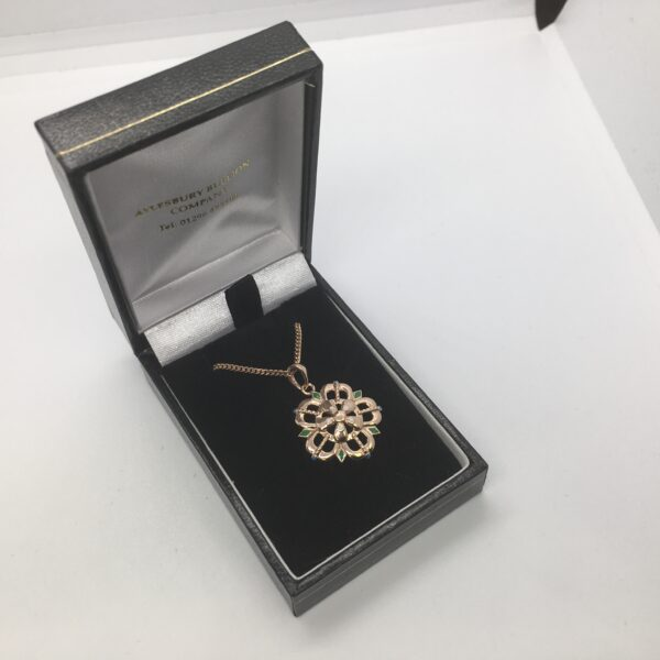 Sterling silver rose gold plated flower pendant on a chain