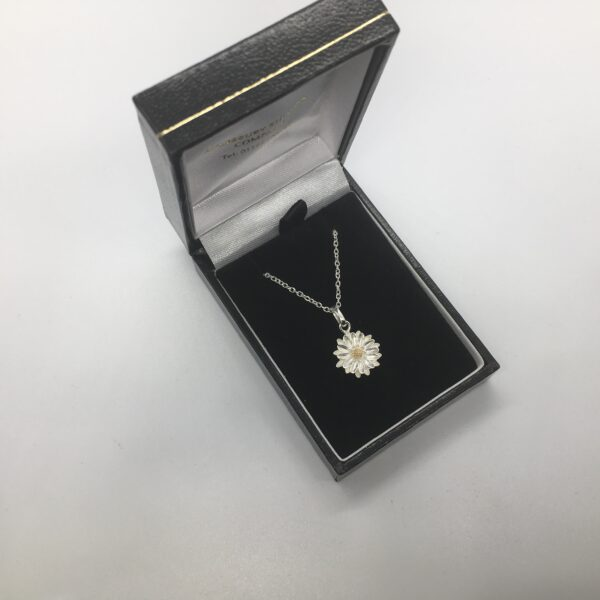 Sterling silver flower pendant on a chain