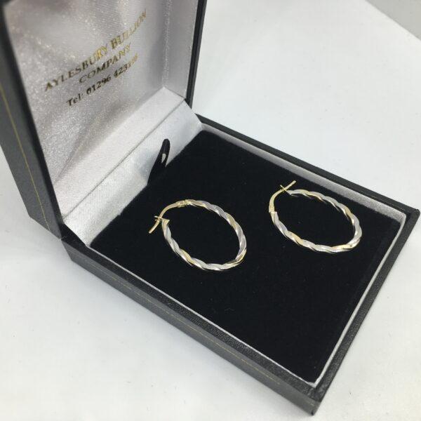 9 carat 2 colour gold oval hoop earrings