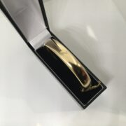 Preowned 9 carat yellow gold hinged bangle