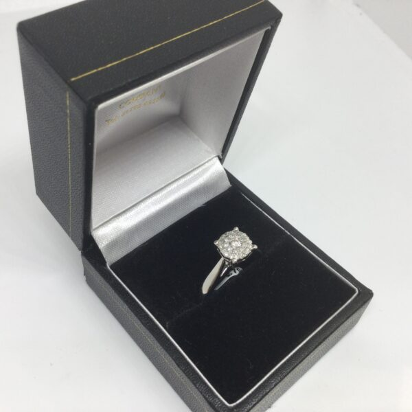 Preowned 18 carat white gold diamond cluster ring