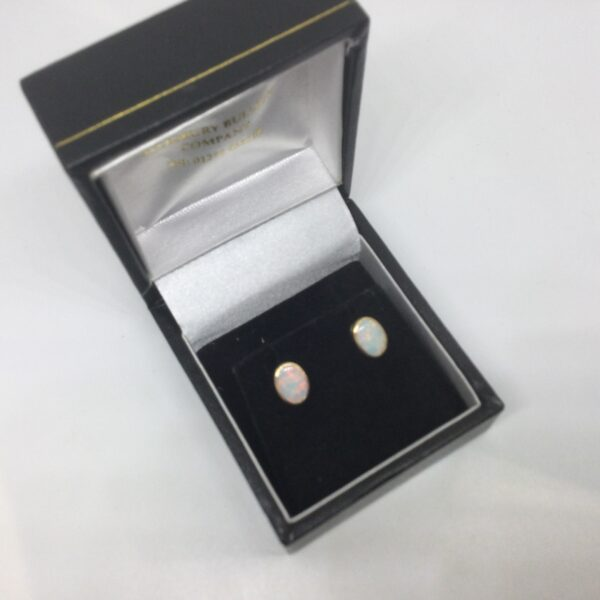 Preowned 18 carat yellow gold opal stud earrings