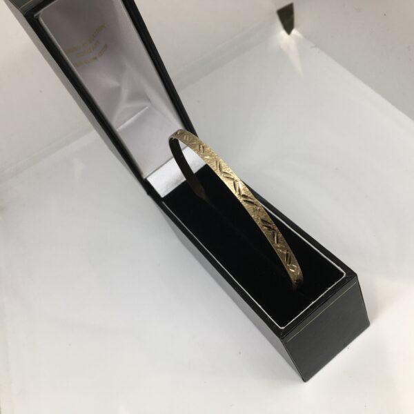 Preowned 9 carat yellow gold bangle