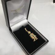 Preowned 9 carat yellow gold stone set clown pendant