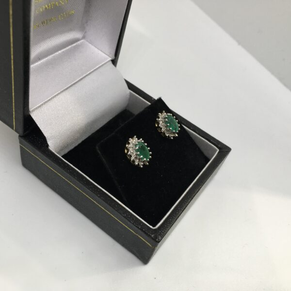 Preowned 9 carat yellow gold emerald and diamond earrings