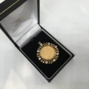Preowned 9 carat yellow gold 1/2 sovereign pendant
