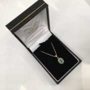 Preowned 9 carat yellow gold emerald and diamond pendant and chain
