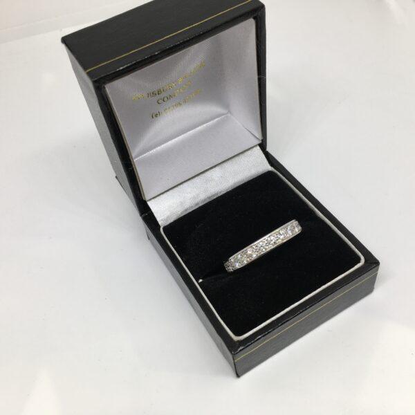 Preowned 18 carat white gold diamond set band/ eternity ring