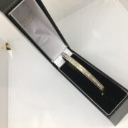 Preowned 18 carat yellow gold diamond bangle