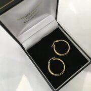 9 carat yellow gold tubular hoop earrings