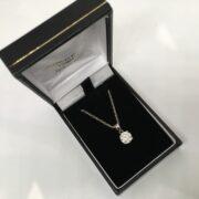 Preowned 18 carat white gold single stone diamond pendant and chain