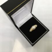 Preowned 9 carat yellow gold pearl and diamond ring