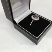 18 carat white gold amethyst and diamond cluster ring