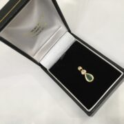 Preowned 9 carat yellow gold emerald and diamond pendant