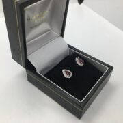 9 carat white gold ruby and diamond stud earrings